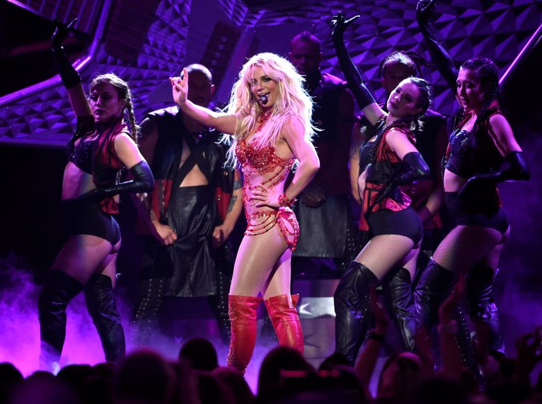 FILE – In a Sunday, May 22, 2016 file photo, Britney Spears performs at the Billboard Music Awards at the T-Mobile Arena, in Las Vegas. Spears is giving the clothes off her back to raise money for the Red Cross to benefit victims of widespread flooding in her home state of Louisiana. She tweeted out links to a fundraising site offering $10 raffle tickets to win an outfit from her upcoming performance on Sunday's MTV Video Music Awards or win a trip to New York to see her at the show in person. (Photo by Chris Pizzello/Invision/AP, File)