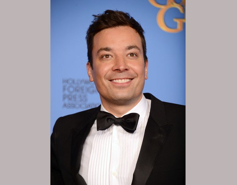 FILE – In this Jan. 12, 2014 file photo, Jimmy Fallon poses in the press room at the 71st annual Golden Globe Awards in Beverly Hills, Calif. Fallon will host the 74th annual Golden Globe Awards, Sunday, Jan. 8, 2017. (Photo by Jordan Strauss/Invision/AP, File)