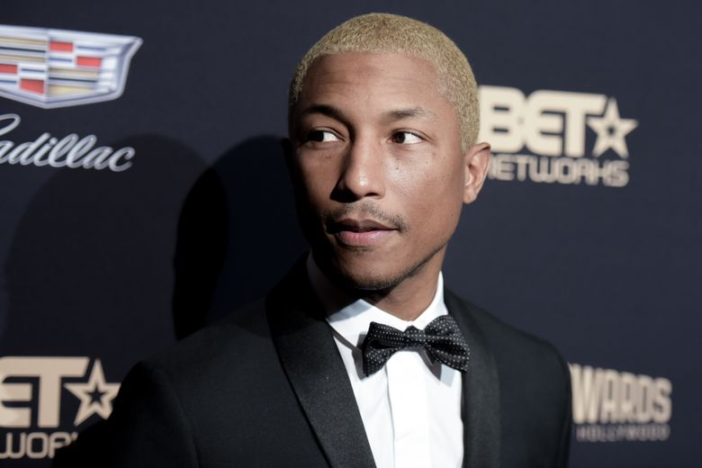 """FILE- In this Feb. 21, 2016, file photo, Pharrell Williams attends the 2016 ABFF Awards: A Celebration of Hollywood held at the Beverly Hilton Hotel in Beverly Hills, Calif. Clive Davis is honoring the """"Happy"""" and """"Freedom"""" singer-songwriter with his Legend in Songwriting Award. Pharrell is scheduled to receive the honor Sept. 15 from the veteran music executive at the 12th annual Songs of Hope event. (Photo by Richard Shotwell/Invision/AP, File)"""