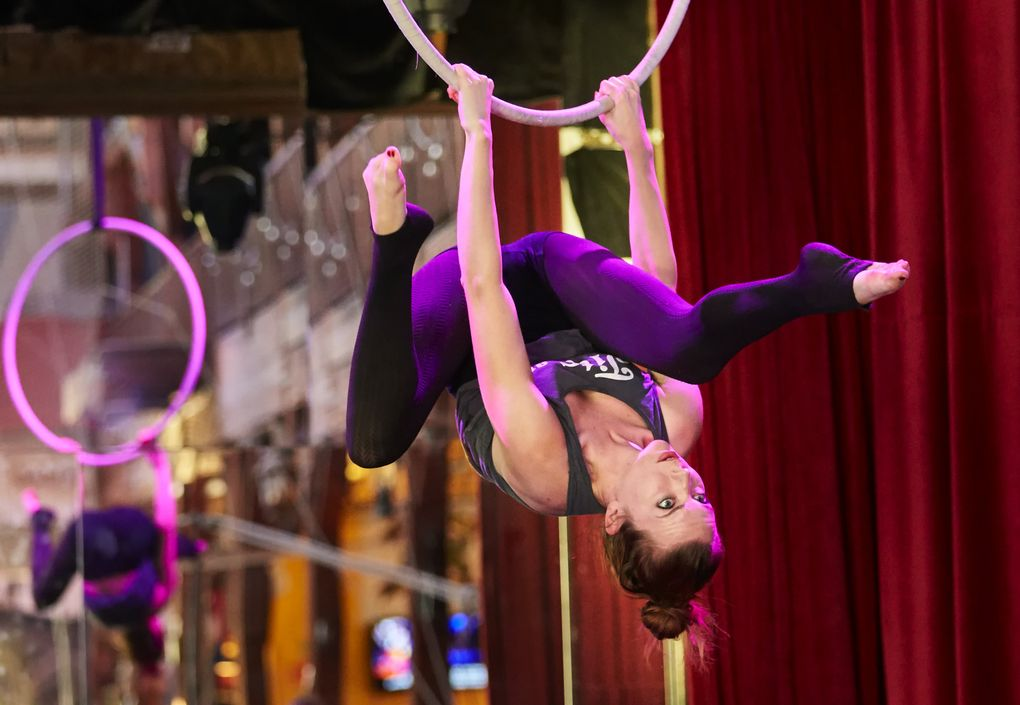 Charlotte Kasal practices at Emerald City Trapeze Arts. (Benjamin Benschneider/The Seattle Times)