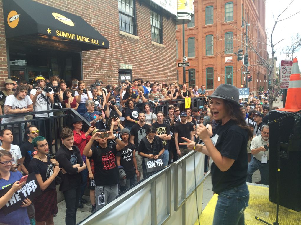 """Canadian actor Evangeline Lilly speaks to the crowd in July before the """"Rock Against the TPP"""" kickoff concert in Denver. (Courtesy of """"Rock Against the TPP"""")"""