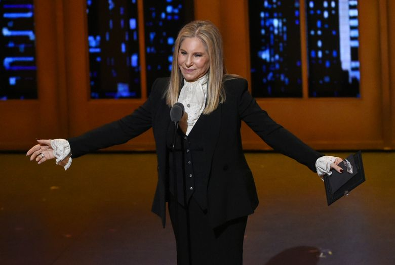 """FILE – In this June 12, 2016 file photo, Barbra Streisand presents the award for best musical at the Tony Awards in New York. Streisand's 36th studio album, """"Encore: Movie Partners Sing Broadway,"""" is a compilation of Broadway duets with some of her friends and favorite actors, including Anne Hathaway, Daisy Ridley, Hugh Jackman, Chris Pine and Bradley Cooper.  (Photo by Evan Agostini/Invision/AP, File)"""