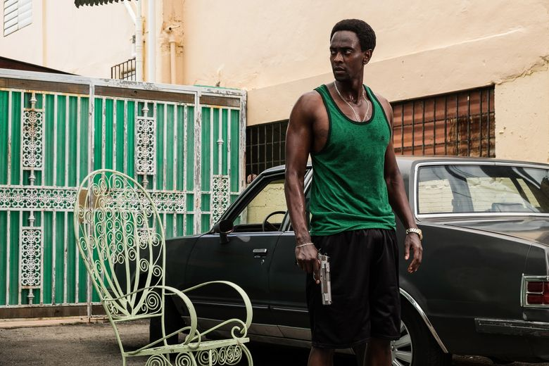 """In this image provided by Crackle, Edi Gathegi plays Haitian-American gangster Ronald Dacey in the new Crackle techno-thriller """"StartUp."""" It premieres Tuesday, Sept. 6, 2016, on the streaming service. (Francisco Roman/Crackle via AP)"""