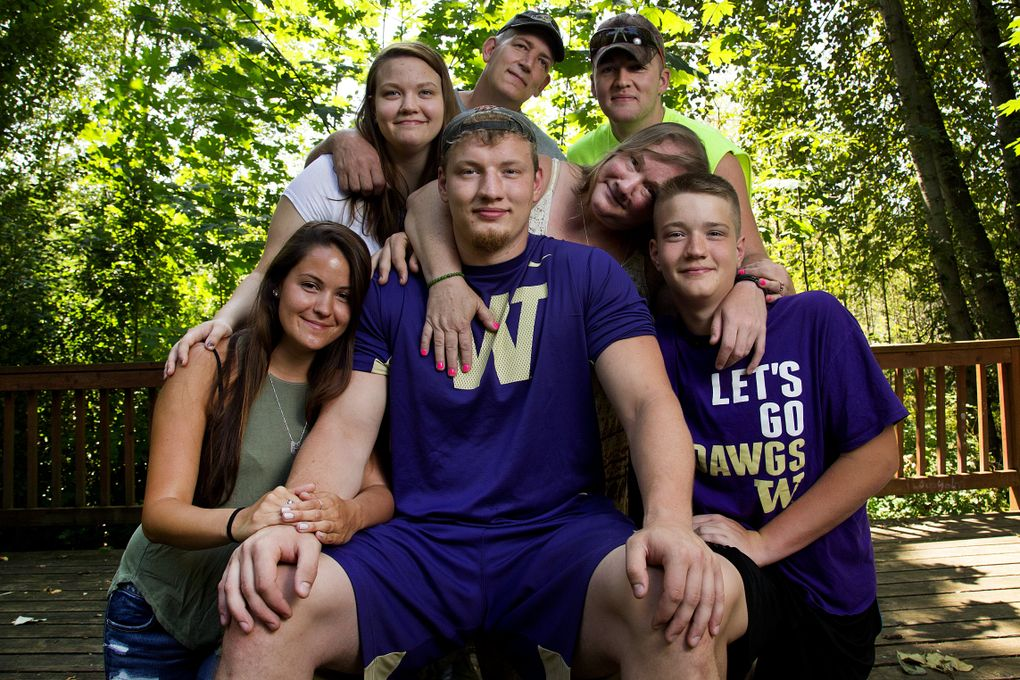 University of Washington offensive lineman Kaleb McGary is surrounded by family members and friends on the Hylebos Wildlife Trail in Fife.  (Johnny Andrews/The Seattle Times)