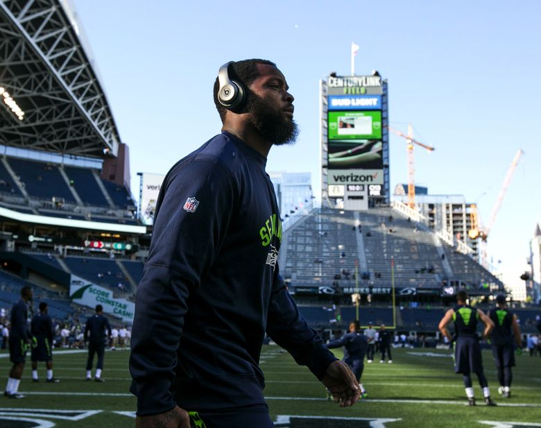 Seahawks defensive lineman Michael Bennett takes the field before facing the Dallas Cowboys in a preseason game. (Bettina Hansen / The Seattle Times)