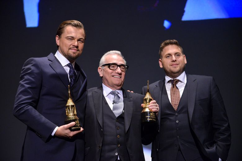 FILE – In this Feb, 6, 2014, file photo, Leonardo DiCaprio, Martin Scorsese, and Jonah Hill are seen onstage at 2014 Santa Barbara International Film Festival – Cinema Vanguard Award ceremony in Santa Barbara, Calif. A video posted online by E! on August 2, 2016, shows DiCaprio pranking Hill on a New York City street. (Photo by Richard Shotwell/Invision/AP, File)