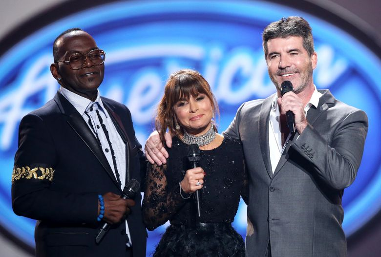 """FILE – In this April 7, 2016 file photo, former judges Randy Jackson, from left, Paula Abdul, and Simon Cowell appear at the """"American Idol"""" farewell season finale in Los Angeles.  The show is receiving the TV academy's 2016 Governors Award for its impact on television. The academy said Friday, Aug. 19, that the Fox singing contest was more than a hit, citing its use of social media, influence on the pop-culture conversation _ and the talent-show imitators it spawned. (Photo by Matt Sayles/Invision/AP, File)"""