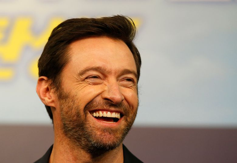 FILE – In this March 7, 2016, file photo, actor Hugh Jackman smiles during a press conference in Seoul, South Korea. Jackman posted a photo on Instagram Aug. 10, 2016, that has prompted speculation about his appearance. (AP Photo/Lee Jin-man, File)