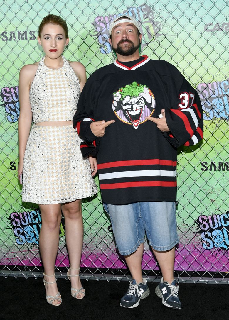 """FILE – In this Aug. 1, 2016, file photo, Harley Quinn Smith, left, and her father, Kevin Smith, attend the world premiere of """"Suicide Squad"""" at the Beacon Theatre in New York. Kevin Smith took to Facebook on Aug. 15, 2016, to slam an online troll for criticizing his daughter. (Photo by Evan Agostini/Invision/AP, File)"""