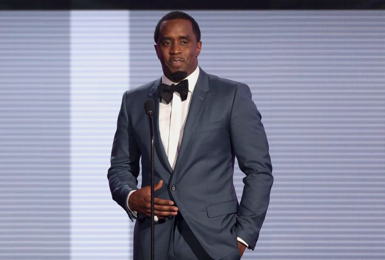 """FILE – In this Nov. 22, 2015 file photo, Sean """"Diddy"""" Combs presents the award for best collaboration of the year at the American Music Awards at the Microsoft Theater in Los Angeles. Combs will be kicking off his tour later than expected after undergoing surgery for a shoulder injury. The rapper and business mogul announced Friday, Aug. 19, 2016, that his Bad Boy Family Reunion Tour will now begin Sept. 1 in Chicago to give him more time to recover from surgery. (Photo by Matt Sayles/Invision/AP, File)"""