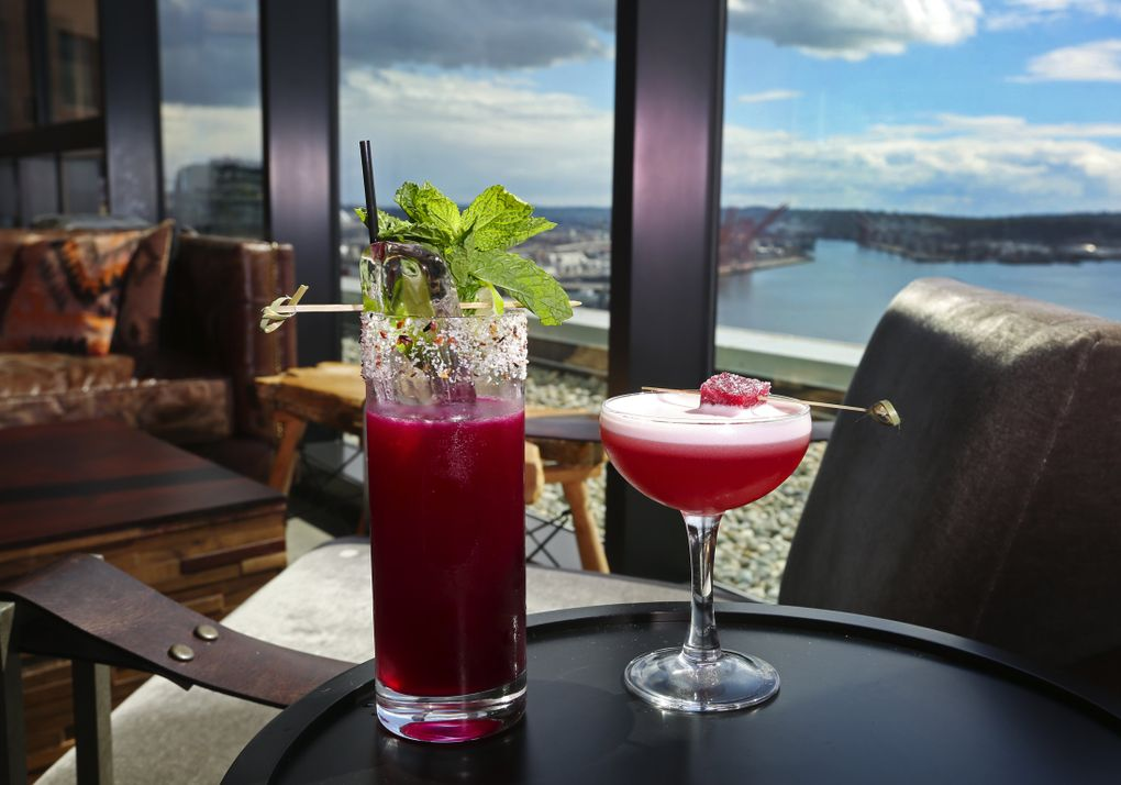 The Nest, on the roof of the Thompson Hotel, has a view that is tough to beat. Enjoy it with one of many cocktails named after birds. Last summer: Caracara, on the left, and the Brazilian Ruby, on the right. (Ken Lambert/The Seattle Times)