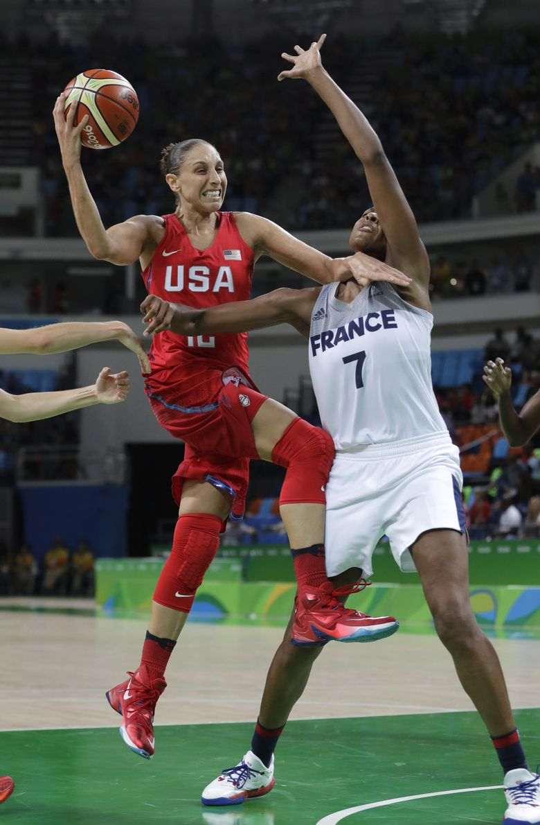Diana Taurasi, left, scored 18 points for the U.S., which remained in line for its sixth straight Olympic gold medal in women's basketball. (Eric Gay/AP)