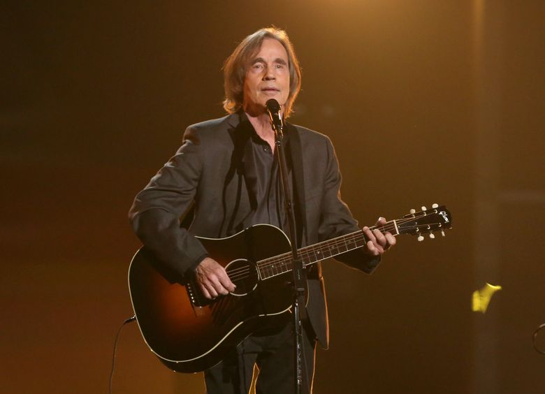 """FILE – In this Feb. 15, 2016 file photo, Jackson Browne performs """"Take It Easy"""" during a tribute to Glenn Frey at the 58th annual Grammy Awards in Los Angeles. Browne, Eddie Vedder and Roseanne Cash will headline at New York's Beacon Theatre as part of the livestreamed Concert Across America to End Gun Violence. Organizers said Thursday, Sept. 15, it's one of the Sept. 25 events featuring more than 1,000 artists at 250 venues across the U.S. (Photo by Matt Sayles/Invision/AP, File)"""