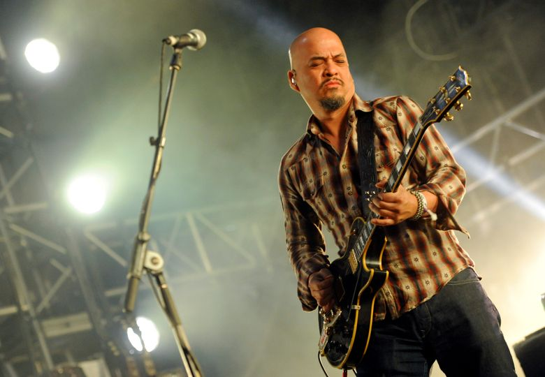 """FILE – In this April 12, 2014 file photo, Joey Santiago of The Pixies performs at the 2014 Coachella Music and Arts Festival  in Indio, Calif.  Santiago has checked into a rehabilitation center for drug and alcohol issues. His Pixies band mates Black Francis, David Lovering and Paz Lenchantin said in a statement Friday, Sept. 16, 2016 that Santiago will be in a rehab center for """"at least 30 days."""" No more details were provided.(Photo by Chris Pizzello/Invision/AP)"""