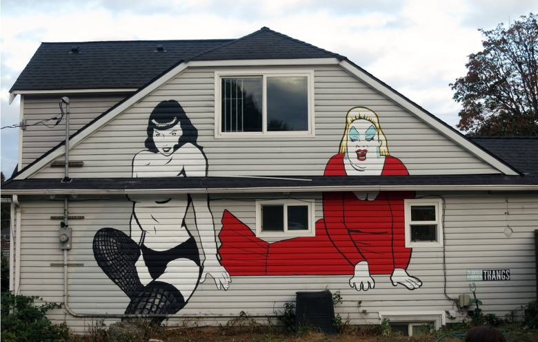 The finished 18-foot Bettie Page mural, with a 12-foot Divine alongside it. (Matthew Brennan IV)