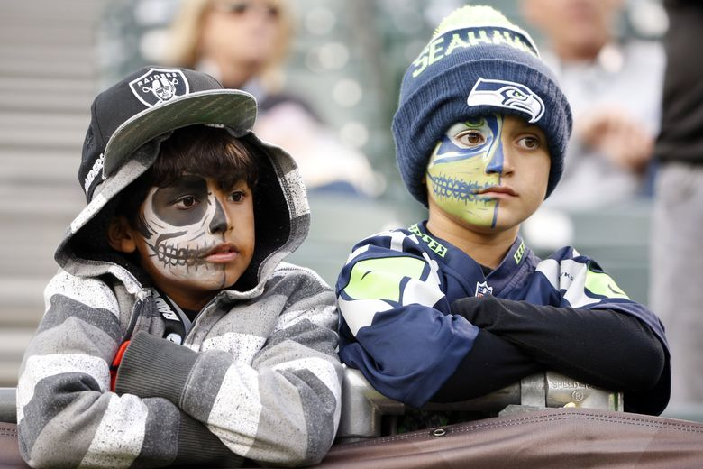 Fans watch from the stands before a preseason NFL football game between the Oakland Raiders and the Seattle Seahawk. (AP Photo/Tony Avelar)