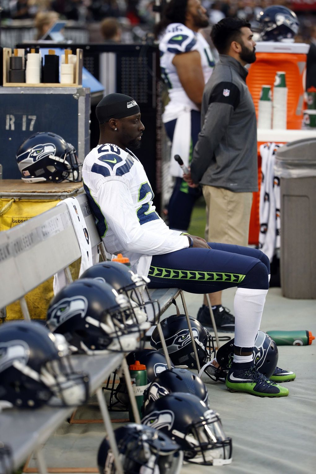 Seahawks cornerback Jeremy Lane sits as the national anthem plays before a preseason game against the Raiders on Thursday in Oakland. (Tony Avelar / AP)
