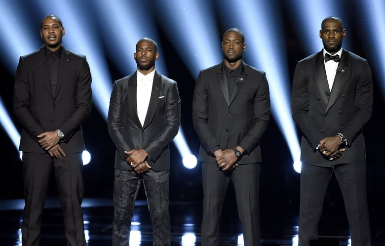 In this July 13, 2016, file photo, NBA basketball players Carmelo Anthony, Chris Paul, Dwyane Wade and LeBron James, from left, speak on stage at the ESPY Awards in Los Angeles. The four gave an anti-violence speech and expressed their support of the values behind the Black Lives Matter movement.(Photo by Chris Pizzello/Invision/AP, File)  (Chris Pizzello / AP)