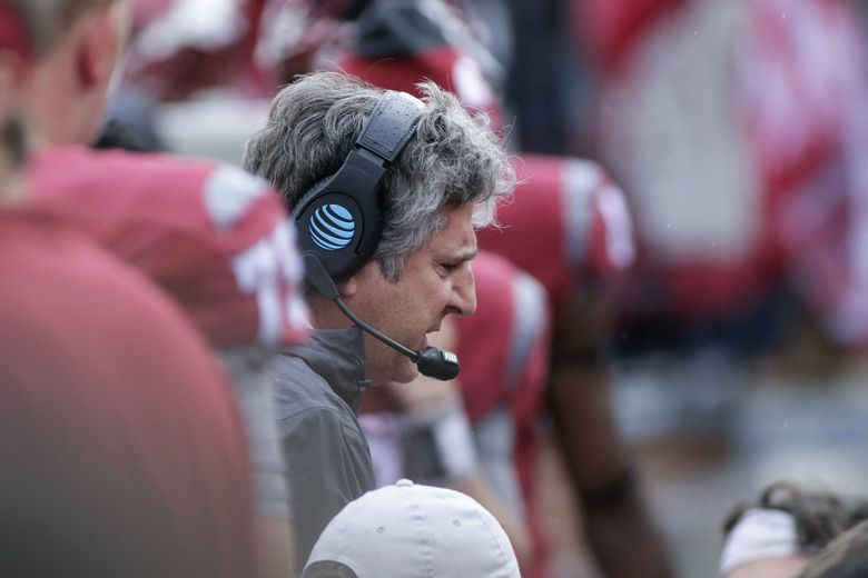 Washington State head coach Mike Leach speaks with his players on the sideline during the first half of an NCAA college football game against Idaho in Pullman, Wash., Saturday, Sept. 17, 2016. (AP Photo/Young Kwak)