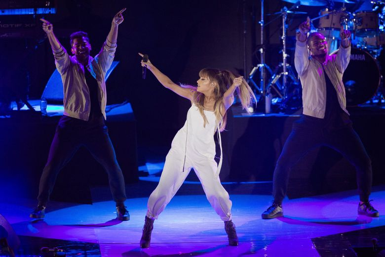 Singer Ariana Grande performs during Macy's Presents Fashion's Front Row, Wednesday, Sept. 7, 2016, in New York. (Andres Kudacki / The Associated Press)