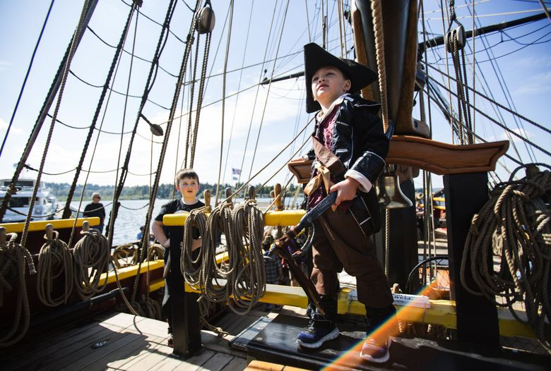 Jonas Torset, 5, of Stanwood, poses for a photo in his pirate gear on Lady Washington during the return of the Historic Tall Ships at Carillon Point in Kirkland  in 2015. (Lindsey Wasson / The Seattle Times)