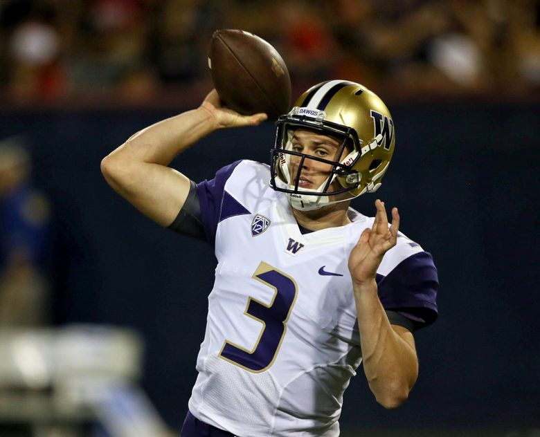Jake Browning warms up for a game against the Arizona Wildcats on Saturday in Tucson.  (Johnny Andrews / The Seattle Times)