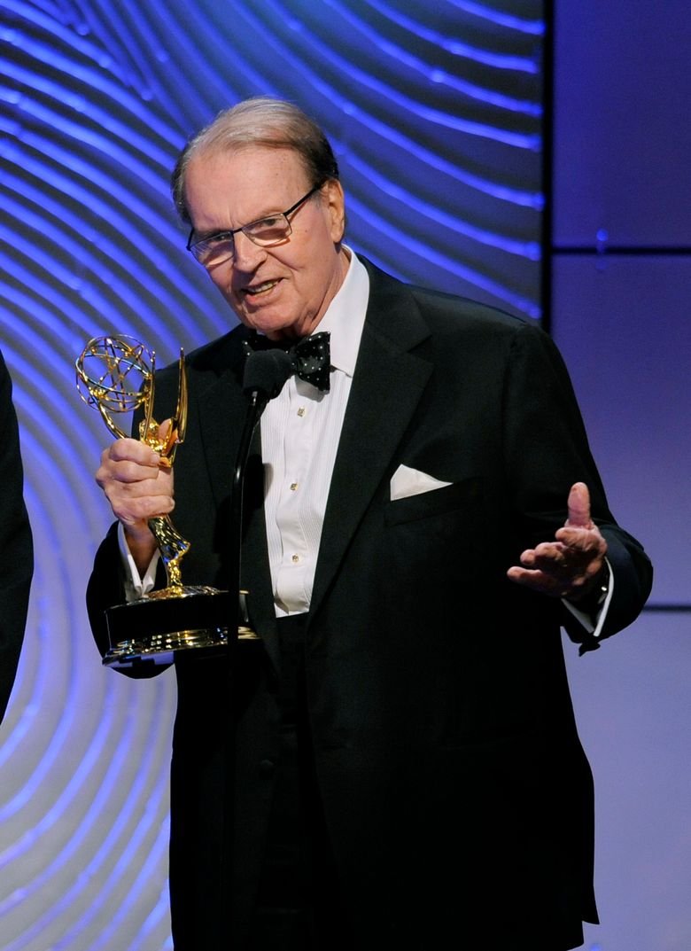 """FILE – In this June 16, 2013 file photo, Charles Osgood accepts the award for outstanding morning program for """"CBS Sunday Morning"""" at the 40th Annual Daytime Emmy Awards in Beverly Hills, Calif.  CBS says it will donate the bow tie that Osgood wears Sunday to host his final edition of """"Sunday Morning"""" to the Smithsonian's National Museum of American History. The 83-year-old newsman is stepping down, Sunday, Sept. 25, 2016,  after 22 years as anchor of the leisurely-paced """"Sunday Morning,"""" which usually dominates the news ratings on that day.(Photo by Chris Pizzello/Invision/AP)"""
