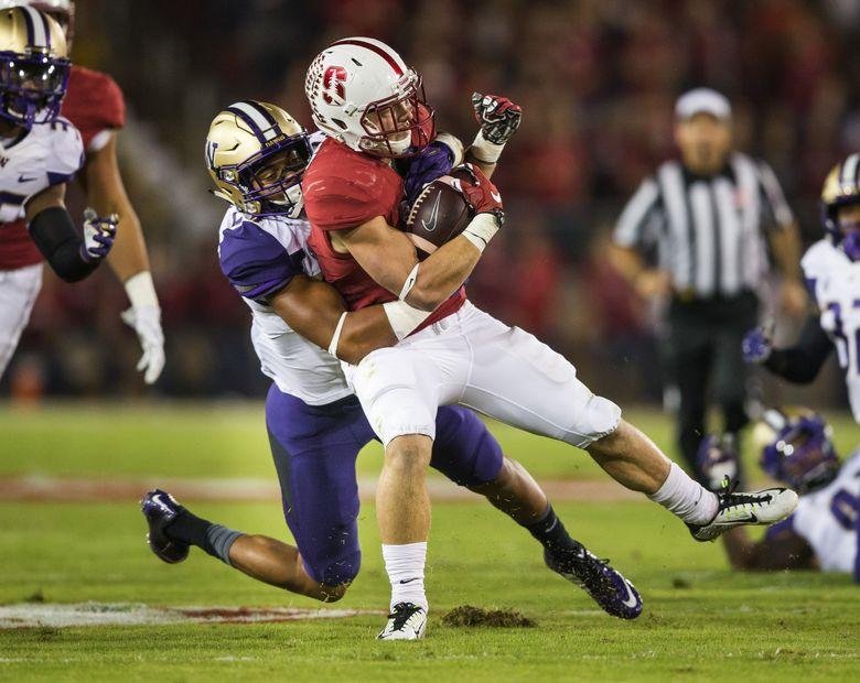 Washington's Ezekiel Turner pulls down Stanford running back Christian McCaffrey after a 9-yard pickup to the 21.  Washington played Stanford Saturday, Oct. 25, 2015 in Palo Alto, Calif. (Dean Rutz/The Seattle Times)