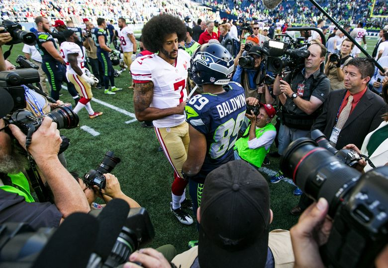 San Francisco 49ers quarterback Colin Kaepernick talks with Seattle Seahawks wide receiver Doug Baldwin after the Seattle Seahawks defeated the San Francisco 49ers 37-18 at CenturyLink Field. (Bettina Hansen/The Seattle Times)