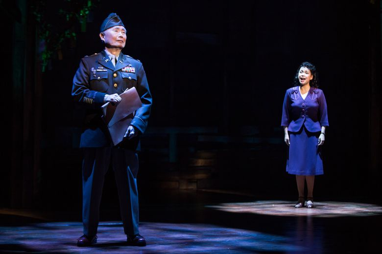 """This image provided by The O & M Company shows actress Lea Salonga, right, with George Takei during a performance of """"Allegiance,"""" in New York. Fathom Events will broadcast a digital recording of the show to movie houses nationwide on Dec. 13.  (Matthew Murphy/The O & M Company via AP)"""