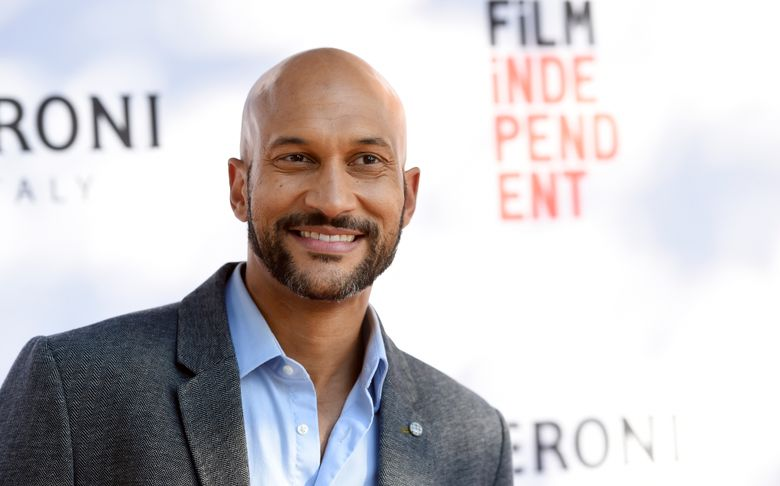 """FILE – In this June 6, 2016 file photo, Keegan-Michael Key, a cast member in """"Don't Think Twice,"""" poses at the premiere of the film during the Los Angeles Film Festival at the ArcLight Culver City in Culver City, Calif.  For nominees, Emmy Day can be a break from calorie counting Summary: Even those Hollywood stars who are most diligent about diet and exercise give in to temptation on special occasions, such as Emmy day.  """"Sunday morning, I'm going to try to eat,"""" said Keegan-Michael Key, a four-time nominee this year, including Outstanding Supporting Actor in a Comedy Series for the sketch show """"Key & Peele."""" (Photo by Chris Pizzello/Invision/AP)"""