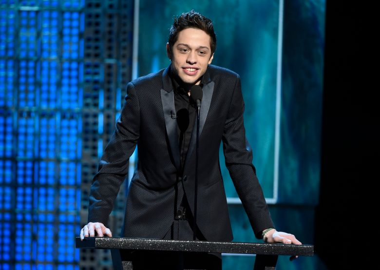 """FILE – In this March 14, 2015, file photo, Pete Davidson speaks at a Comedy Central Roast at Sony Pictures Studios in Culver City, Calif. The """"Saturday Night Live"""" cast member Davidson is paying tribute to his late father, a New York City firefighter who died while responding to the Sept. 11 attacks. He posted several photos of his dad to Instagram on the 15th anniversary of the attacks Sunday, Sept. 11, 2016. (Photo by Chris Pizzello/Invision/AP, File)"""
