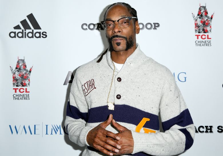 """FILE- In this May 16, 2016, file photo, Snoop Dogg arrives at the LA Premiere of """"Coach Snoop"""" at the TCL Chinese 6 Theatres in Los Angeles. Snoop Dogg, known for his ultra-smooth West Coast swagger and rap style, will be honored with the """"I Am Hip Hop"""" award at the 11th annual BET Hip-Hop Awards. BET said Tuesday, Sept. 13, that Snoop Dogg will receive the award on Saturday during the taped event at the Cobb Energy Performing Centre in Atlanta. The show will on BET on Oct. 4. (Photo by Rich Fury/Invision/AP, File)"""
