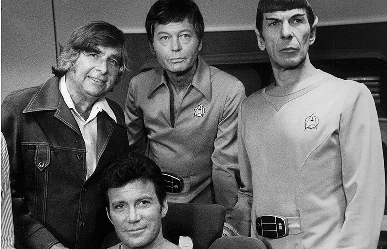 FILE– Gene Roddenberry, left, William Shatner, seated, DeForest Kelley, center,  and Leonard Nimoy, right, pose for a photograph after the final rehearsal before filming 'Star Trek – The Motion Picture' in this August 1978 file photo. Kelley, who played  Dr. Leonard 'Bones' McCoy, died in suburban Woodland Hills, Calif., Friday, June 11, 1999, after an extended illness, hospital officials said. He was 79. (AP Photo/File)