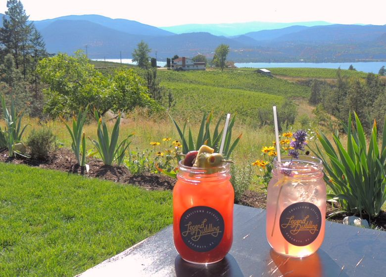 Visitors to Legend Distilling's tasting room in Naramata, B.C., can cool off with cocktails served on an outdoor patio overlooking Okanagan Lake.  (Carol Pucci / Special to The Seattle Times)