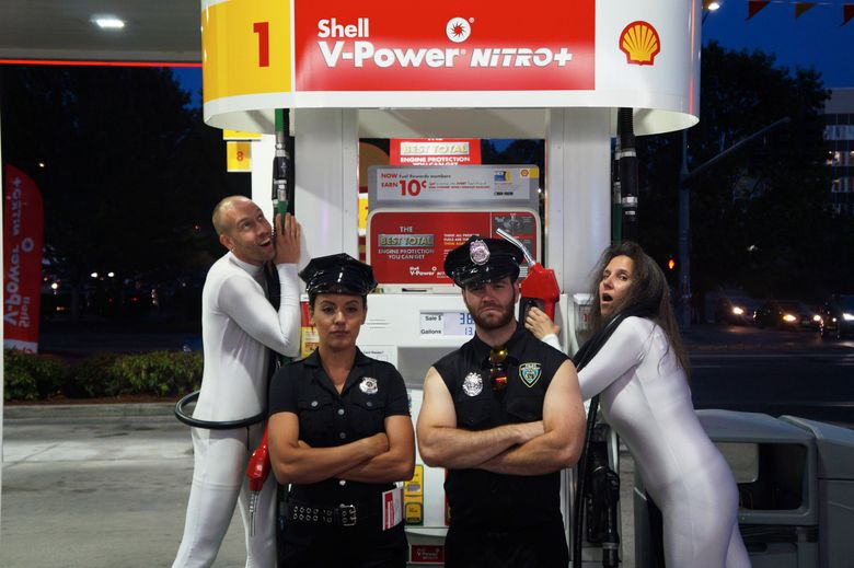 """Mixing light protest with commedia dell'arte-style street theater, Seattle performance group Coltura challenges dependence on gasoline with two types of characters: the """"gas ghosts"""" and the """"carbon cops."""" (Courtesy of Coltura)"""
