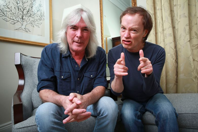 """FILE – In this Nov. 13, 2014 file photo, members of the rock band AC/DC, bassist Cliff Williams, left, and guitarist Angus Young pose for a portrait in promotion of their upcoming album, """"Rock or Bust"""" in New York. Williams announced his retirement from the group in a YouTube video posted on Sept. 20, 2016. (Photo by Amy Sussman/Invision/AP, File)"""