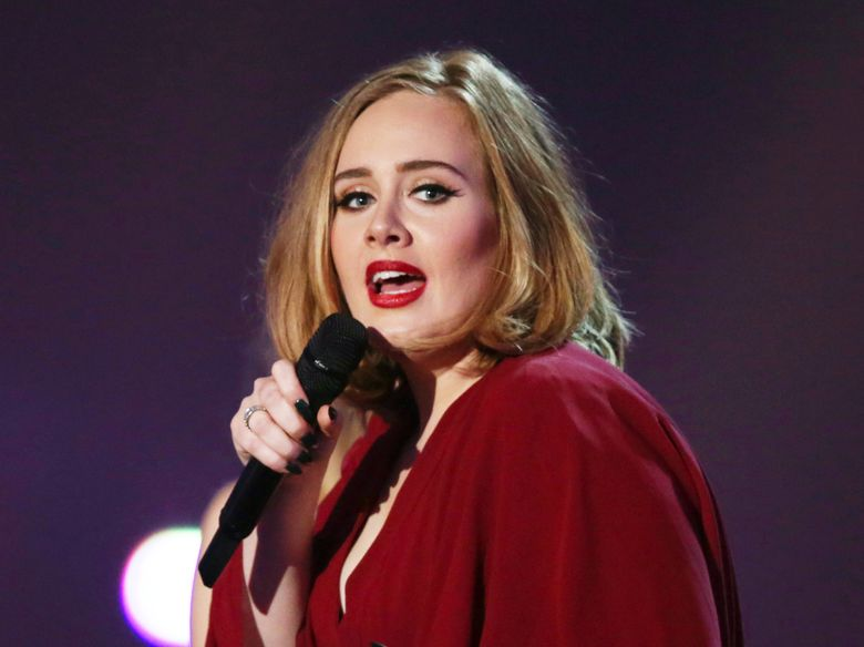 """FILE – In this Feb. 24, 2016 file photo shows Adele onstage at the Brit Awards 2016 at the 02 Arena in London. Adele told the crowd at her show in New York City on Sept. 20, 2016, that news of Brad Pitt and Angelina Jolie's divorce """"feels like the end of an era."""" (Photo by Joel Ryan/Invision/AP, File)"""