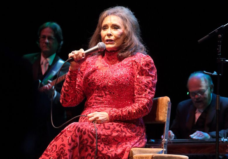 FILE – In this Aug. 28, 2016 file photo, Loretta Lynn performs in concert at the American Music Theater in Lancaster, Pa. Lynn has postponed shows after suffering injuries in a fall that will require minor surgery. Her injuries were described as not serious, but a statement posted on her website on Wednesday, Sept. 7, said her doctors have advised her to stay off the road until she's made a full recovery.  (Photo by Owen Sweeney/Invision/AP, File)