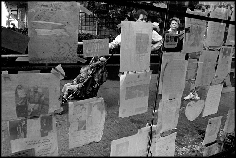 """Posters on a bus shelter on Seventh Avenue, New York, 2001, from """"Stepping Through the Ashes"""" by Eugene Richards  (Courtesy PCNW)"""