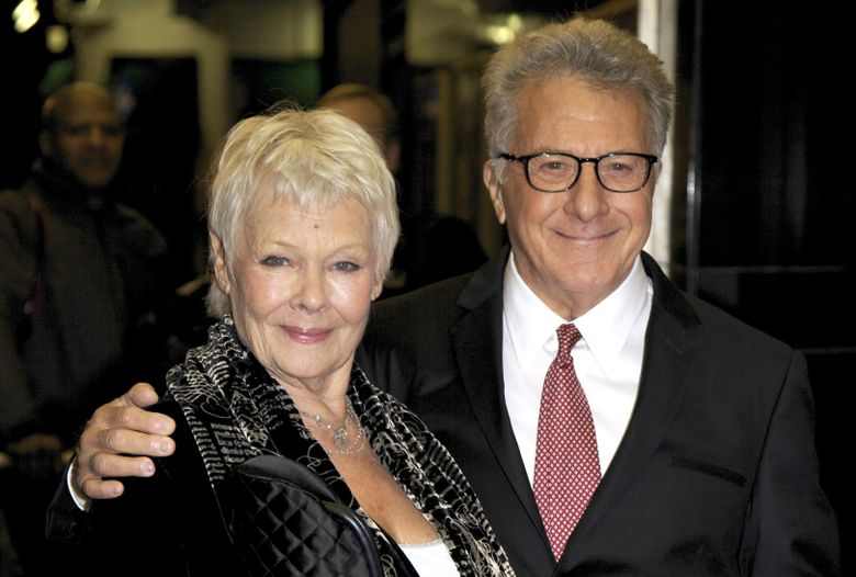 """FILE – In this Nov. 12, 2014 file photo, actors Judi Dench, left, and Dustin Hoffman pose for photographers upon arrival at the screening of """"Roald Dahl's Esio Trot: Deleted Scenes,"""" in London. The pair are nominated for International Emmys for their roles in the BBC One TV movie. (Photo by Grant Pollard/Invision/AP, File)"""