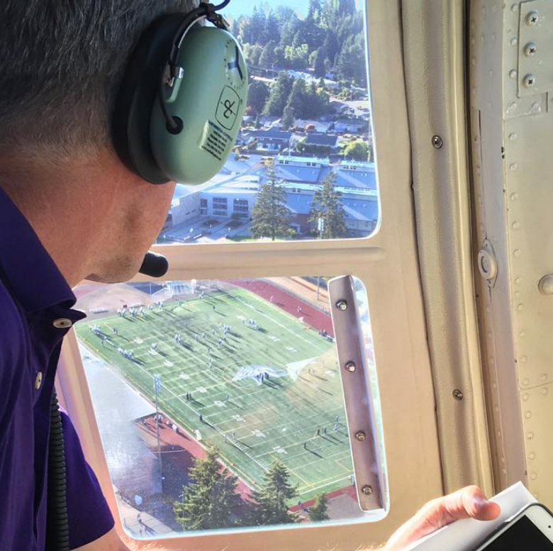 UW coach Chris Petersen looks down from a helicopter hovering over Curtis High School on Friday during the Huskies' recruitment of top lineman Foster Sarell of Graham-Kapowsin. (Photo via Twitter: @BushHamdan)