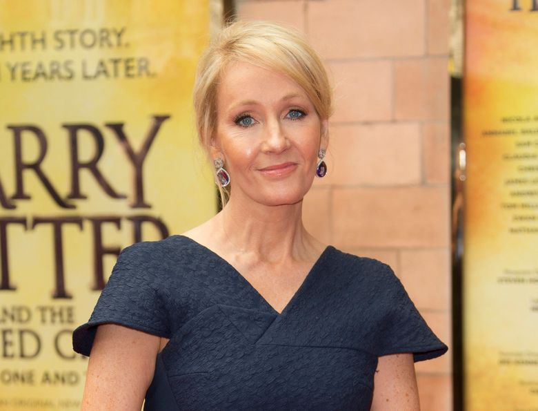 """FILE – In this July 30, 2016, file photo, writer J.K. Rowling poses for photographers upon arrival at gala performance of """"Harry Potter and the Cursed Child,"""" in central London. Rowling clarified on Sept. 22, 2016, that slain Ohio gorilla, Harambe, is not a part of her fictional universe. The comment on Twitter came after Rowling retweeted a fake photo of Harambe as a result on the Patronus page of her Pottermore website. (Photo by Joel Ryan/Invision/AP, File)"""