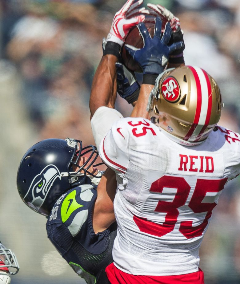 San Francisco's Eric Reid looked in perfect position to make an interception, until Seattle's Jimmy Graham came up to rip the ball away for a 40-yard reception. 'That was savage,' Seattle's Luke Willson said. (Dean Rutz/The Seattle Times)