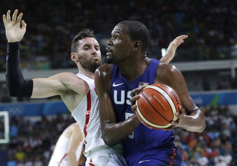 Kevin Durant, right, drives to the basket against Spain's Ricky Rubio during the Olympics. Durant was in Seattle on Friday, back in the city where he played his rookie season in the NBA. (Eric Gay/AP)