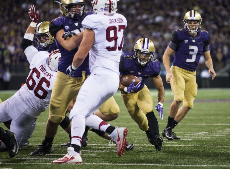 Jake Browning (3) watches as running back Myles Gaskin (9) scored from 8 yards out during the Huskies' 44-6 win over Stanford on Sept. 30, 2016 at Husky Stadium. (Lindsey Wasson/The Seattle Times)