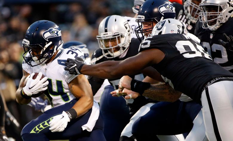 Seahawk Thomas Rawls sees his first action of the preseason against Oakland. Rawls, coming off ankle surgery, had 7 yards on two carries. (Tony Avelar/AP)