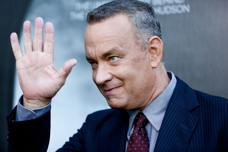 """FILE – In this Sept. 8, 2016, file photo, Tom Hanks arrives at the LA Premiere of """"Sully"""" at The Directors Guild of America Theater in Los Angeles. Hanks stopped to crash the wedding day photo shoot of a couple in New York's Central Park over the weekend. He posted a selfie he took with the bride and groom on Instagram Sunday, Sept. 25, 2016. (Photo by Rich Fury/Invision/AP, File)"""