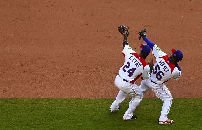 Fernando Rodney, right, and Robinson Cano were part of the Dominican Republic team that went undefeated in the last World Baseball Classic.  (Mike Ehrmann/Getty Images)