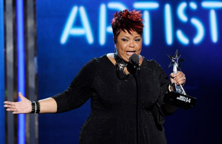 """FILE – In this June 29, 2014 file photo, Tamela Mann accepts the award for best gospel artist at the BET Awards at the Nokia Theatre on  in Los Angeles.   Mann found comfort in her new single """"God Provides"""" after unexpectedly hearing it for the first time on the radio shortly after she was robbed outside an Atlanta restaurant a few months ago. The song is featured on singer and actress' fourth album, """"One Way,"""" which also includes a guest appearance by hit-making producer Timbaland. The album is out Friday, Sept. 9, 2016. (Photo by Chris Pizzello/Invision/AP)"""